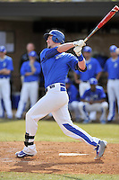Right fielder Kep Brown (24) of the Spartanburg Methodist College Pioneers hits in a junior college game against Surry Community College on January 31, 2016, at Mooneyham Field in Spartanburg, South Carolina. (Tom Priddy/Four Seam Images)