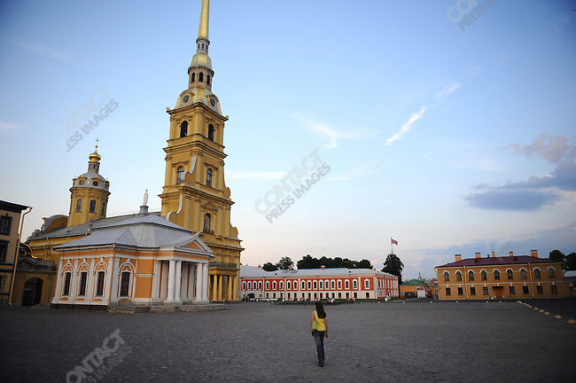 As the sun waned a woman walked inside the walls of the Peter and Paul Fortress, White Nights, St. Petersburg, Russia, July 7, 2010