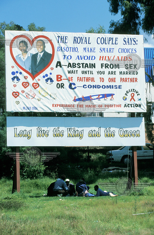 An AIDS education banner featuring celebrity endorsement.