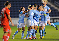 #11 Cristiane of the Chicago Red Stars celebrates with teammates after scoring the game tying goal against    the Washington Freedom. The Red Stars won the game 2-1