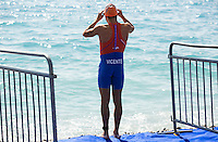 16 SEP 2012 - NICE, FRA - Oscar Vicente of Metz Triathlon prepares for a warm up swim before the start of the French Grand Prix triathlon series final stage held during the Triathlon de Nice Côte d'Azur (PHOTO (C) 2012 NIGEL FARROW)