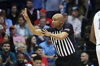 CHAPEL HILL, NC - FEBRUARY 25: Official Bill Covington calls a foul during a game between NC State and North Carolina at Dean E. Smith Center on February 25, 2020 in Chapel Hill, North Carolina.