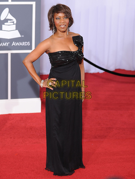 ALFRE WOODARD .Arrivals at the 52nd Annual GRAMMY Awards held at The Staples Center in Los Angeles, California, USA..January 31st, 2010.grammys full length black bow maxi dress hand on hip.CAP/RKE/DVS.©DVS/RockinExposures/Capital Pictures
