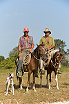 Cow boys with a dog Province de Pinar del Rio