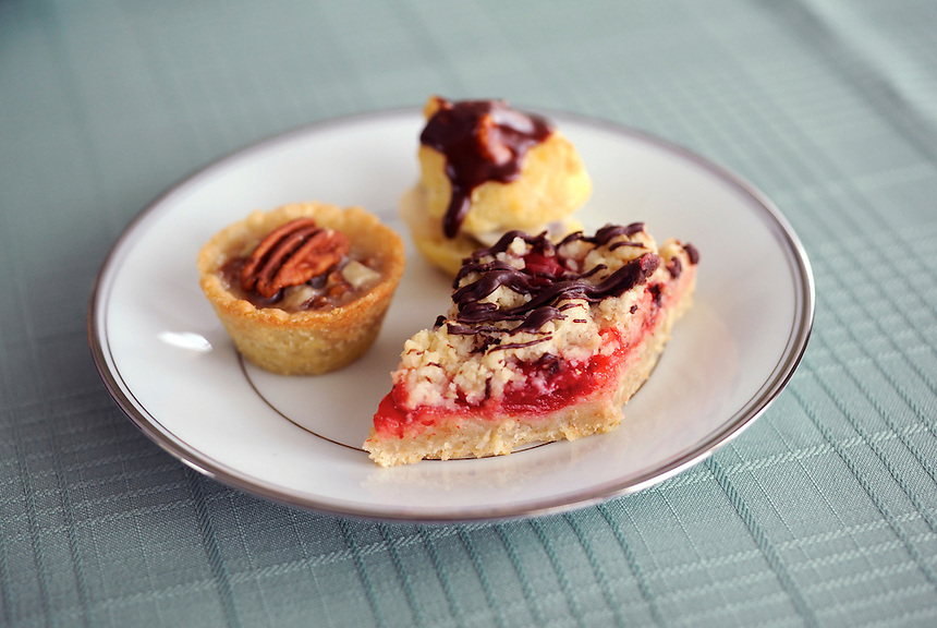 Deserts in Mary Beth Jacobsen's Wauwatosa home include pecan tartlets, ricotta-filled cream puffs and chocolate-drizzled cherry bars. Ernie Mastroianni photp