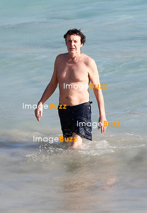 Paul McCartney and his wife Nancy Shevell enjoy a swim while vacationing in St. Barts ...  and the 71-year old singer was awfully spry for his age while diving into the water.<br /> McCartney and wife were staying at Villa Christopher, a luxury 4 star hotel for he price of 2400 euros per night<br /> December 27, 2013.