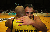 Pero Cameron hugs Brain Wethers after the game finishes during game two of the NBL Final basketball match between the Wellington Saints and Waikato Pistons at TSB Bank Arena, Wellington, New Zealand on Friday 20 June 2008. Photo: Dave Lintott / lintottphoto.co.nz