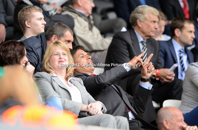Pictured: Chris Coleman (C) manager of the Senior Wales team watching the game. Monday 19 May 2014<br />