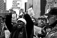 Protestors in downtown Chicago demanding that big corporations pay their fair share of the taxes needed to keep the country running properly instead of shifting the burden to the middle-class wage earners.