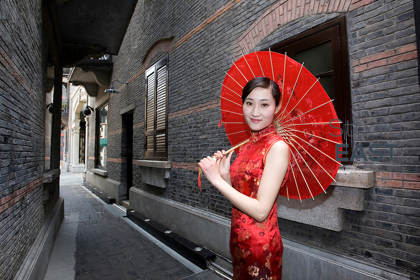 CHEN Nana, a hostess for GL events, poses for a photograph in Xintiandi neighborhood, in Shanghai, China, on April 18, 2010. Chen Nana is 22-year-old and comes from Anhui province in China. Photo Lucas Schifres/Pictobank