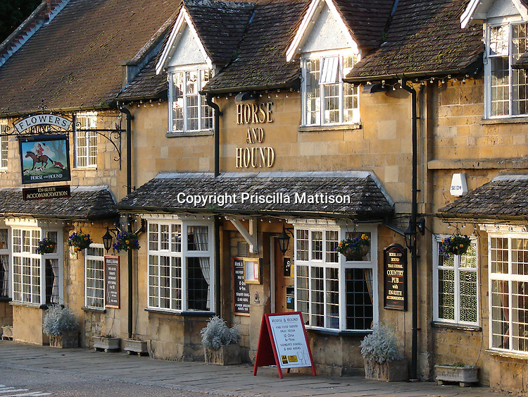 Cotswolds, England - February 1, 2008:  Late afternoon sun reflects on the dormer windows of a pub.