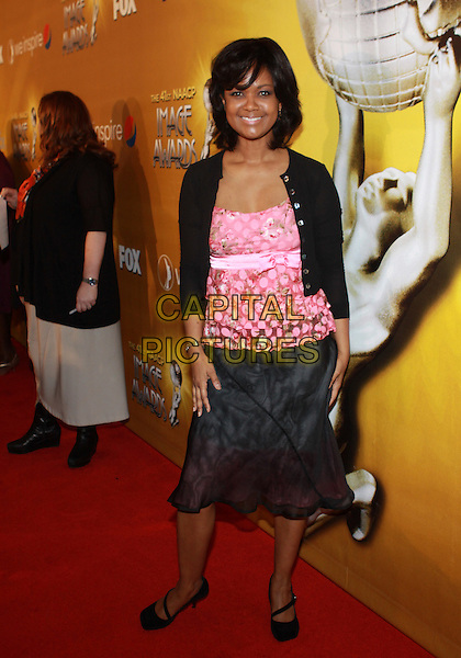 TONYA LEE WILLIAMS .The 41st Annual NAACP Image Awards Nominee Luncheon held at  The Beverly Hills Hotel, Beverly Hills, CA, USA, .13th Febuary 2010..full length black cardigan pink print top skirt .CAP/ADM/TC.©T.Conrad/Admedia/Capital Pictures