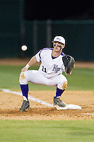 Spencer Angelis (11) of the High Point Panthers waits for a throw at first base during the game against the Coastal Carolina Chanticleers at Willard Stadium on March 14, 2014 in High Point, North Carolina.  The Panthers defeated the Chanticleers 3-0.  (Brian Westerholt/Four Seam Images)