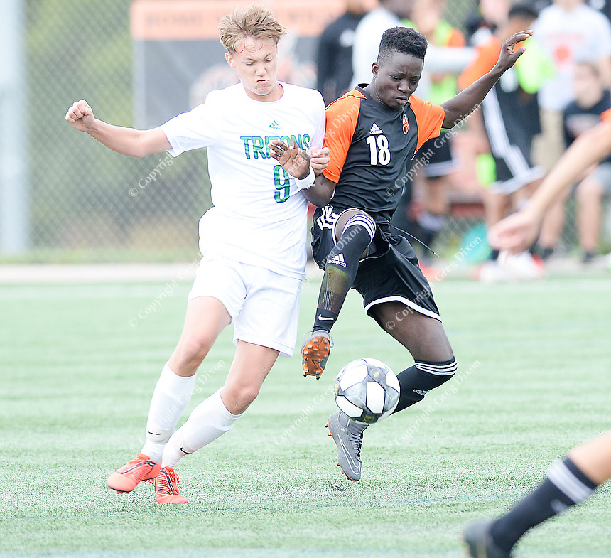 Verona's Stanley Maradiaga (18) fights for the ball with Green Bay Notre Dame's Alex Schwitzer (9), as Verona tops Green Bay Notre Dame 4-0 on Saturday, 8/31/19, in boys high school soccer at Reddan Soccer Park in Verona, Wisconsin | Wisconsin State Journal article page B8 Sports 9/1/19