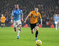 27th December 2019; Molineux Stadium, Wolverhampton, West Midlands, England; English Premier League, Wolverhampton Wanderers versus Manchester City; Ruben Vinagre of Wolverhampton Wanderers gets ahead of Kyle Walker of Manchester City as they both chase down a loose ball