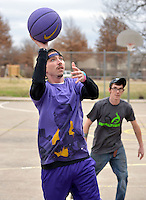 STAFF PHOTO BEN GOFF  @NWABenGoff -- 12/26/14 Kyote (CQ) Holliday shoots a layup while playing basketball with friends and family at Olive Street Park in Rogers on Friday Dec. 26, 2014.