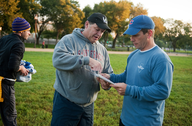 UNITED STATES - OCTOBER 04:  Reps. Bob Dold, R-Ill., right, and Bill Shuster, R-Pa., discuss a play during a congressional football practice on the Mall in preparation for the upcoming game between members of Congress and the Capitol Police.  (Photo By Tom Williams/Roll Call)