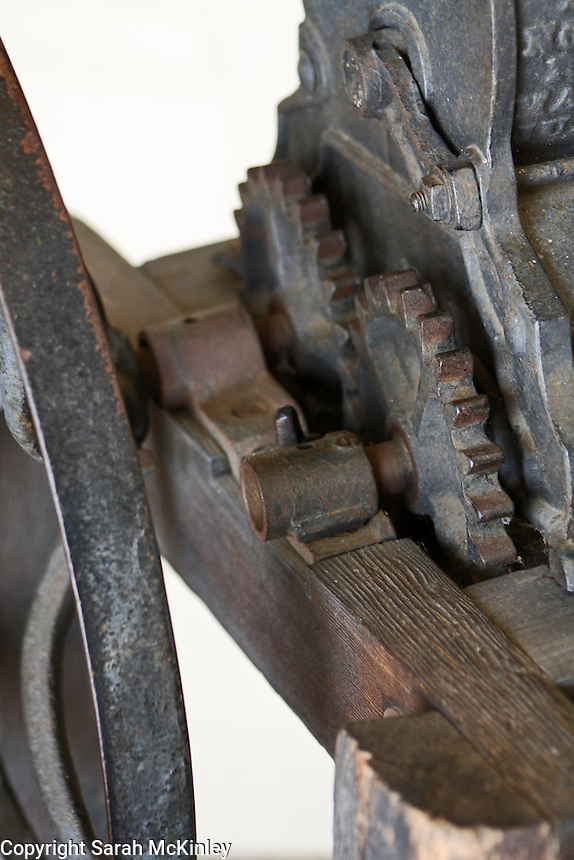 Detail of the gears of an antique press at Mondavi Vineyard near Napa in Napa County in Northern California.