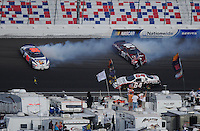 Mar 1, 2008; Las Vegas, NV, USA; Nascar Nationwide Series drivers David Reutimann (99) and Tony Stewart (20) crash during the Sams Town 300 at the Las Vegas Motor Speedway. Mandatory Credit: Mark J. Rebilas-US PRESSWIRE