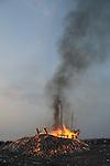 Donggang, Taiwan -- Smouldering heap of the King Boat at dawn.