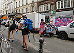VMI Vincentian Heritage Tour: Members of the Vincentian Mission Institute cohort walk through the African community along the Rue du Faubourg near the Porte Saint-Denis, Thursday, June 23, 2016, as they toured Vincentian sites in Paris. (DePaul University/Jamie Moncrief)