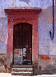 Old faded doorway and poster, Oaxaca, Mexico