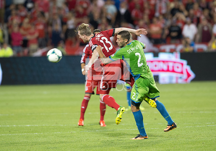 August 10, 2013: Seattle Sounders FC forward Clint Dempsey #2 battles with Toronto FC defender Steven Caldwell #13 during an MLS regular season game between the Seattle Sounders and Toronto FC at BMO Field in Toronto, Ontario Canada.<br /> Seattle Sounders FC won 2-1.