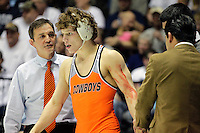 STATE COLLEGE, PA - FEBRUARY 16: Head coach John Smith speaks with Alex Dieringer of the Oklahoma State Cowboys during a 157 pound match against the Penn State Nittany Lions on February 16, 2014 at Rec Hall on the campus of Penn State University in State College, Pennsylvania. Penn State won 23-12. (Photo by Hunter Martin/Getty Images) *** Local Caption *** Alex Dieringer;John Smith