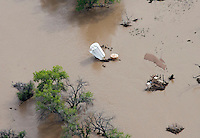 Flooding along St Vrain River in Weld County, Colorado near Greeley.  Oil tank.