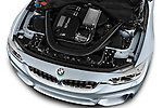 Car Stock 2016 BMW M4 2 Door Coupe Engine  high angle detail view