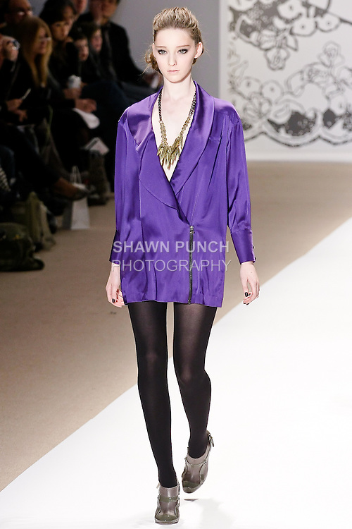Emma Dupont walks the runway in a chantarelle long sleeved mini dress with fuffle lapel in royal purple, and african queen necklace, by Wenlan Chia, for the Twinkle By Welan Fall 2010 fashion show, during Mercedes-Benz Fashion Week Fall 2010.