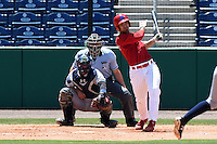 Clearwater Threshers third baseman Harold Martinez (11) at bat in front of catcher catcher Peter O'Brien (24) and umpire Brennan Miller during a game against the Tampa Yankees on April 9, 2014 at Bright House Field in Clearwater, Florida.  Tampa defeated Clearwater 5-3.  (Mike Janes/Four Seam Images)
