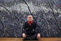 "Zeng Fanzhi, China's renowned contemporary artist, poses for pictures  in his Beijing studio on 9th November, 2012, China. Zeng gained the title of ""Number ONe"" Chinese artist in terms of auction price in 2009.<br /> <br /> PHOTO BY RICKY WONG / SINOPIX"
