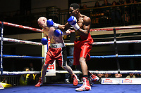 Joshua Ejakpovi (red shorts) defeats Nathan Hardy during a Boxing Show at York Hall on 10th February 2018