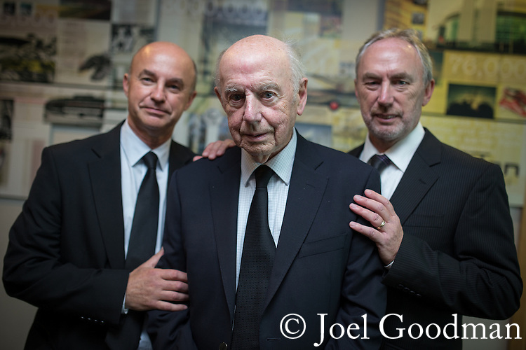 "© Joel Goodman - 07973 332324 . 14/10/2013 . Gorton Monastery , Manchester , UK . L-R son Nick Howard , father (and photographer friend of Harry's) Ron Howard , son Martin Howard . The Humanist funeral of photographer Harry Goodwin , attended by footballers and other celebrities and featuring music by artists he had photographed including ""He Ain't Heavy, He's My Brother"" by the Hollies and "" Happiness "" by Ken Dodd .  Photo credit : Joel Goodman"
