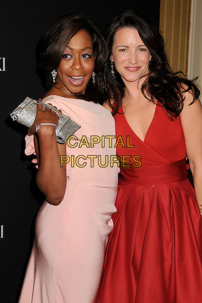 TICHINA ARNOLD & KRISTIN DAVIS.11th Annual Costume Designers Guild Awards at the Four Seasons Beverly Wilshire Hotel, Beverly Hills, California, USA..February 17th, 2009.half length red dress pink mouth open hand silver clutch bag.CAP/ADM/BP.©Byron Purvis/AdMedia/Capital Pictures.