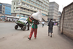 A porter carrys a sack of carrots away from the Wakulima market in downtown Nairobi.