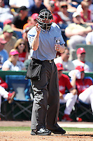 Home plate umpire Mike Estabrook makes a call during a spring training game between the Philadelphia Phillies and Houston Astros at Bright House Field on March 7, 2012 in Clearwater, Florida.  (Mike Janes/Four Seam Images)