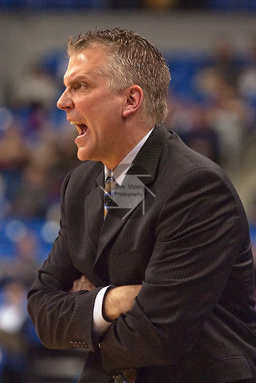 March 22,  2010                                           Wisconsin-Green Bay head coach Tod Kowalczyk yells in to his team in the first half.   The St. Louis University Billikens hosted the University of Wisconsin- Green Bay Phoenix in a quarterfinal (second) round game of the College Basketball Invitational Tournament on Monday March 22, 2010 at Saint Louis University's Chaifetz Arena, located near downtown St. Louis.