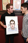 Ben Platt and Steven Levenson during the Ben Platt Sardi's Portrait unveiling at Sardi's on May 30, 2017 in New York City.