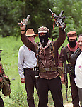 Zapatista sub commander Marcos disarms before boarding a red cross vehicle to transport him from his jungle hideout to peace negotiations in San Cristobal de las Casas, Chiapas, Mexico, 1995