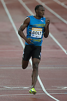 Usain BOLT of Jamaica (Men's 100m) wins his heat during the Sainsburys Anniversary Games Athletics Event at the Olympic Park, London, England on 24 July 2015. Photo by Andy Rowland.
