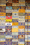 License plate collection on garage.