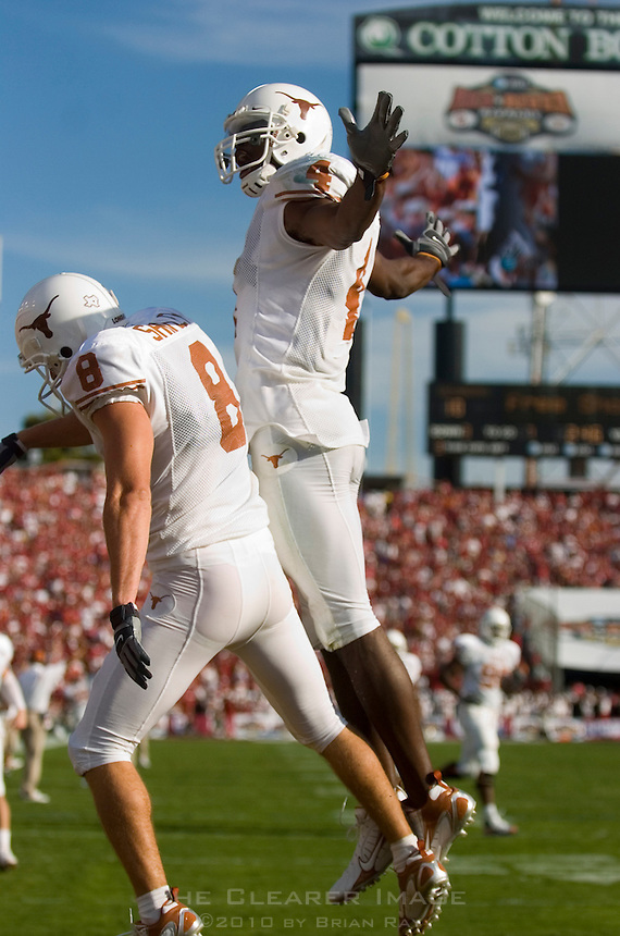 07 October 2006: Texas receiver Limas Sweed (#4) congratulates tight end Jordan Shipley (#8) after Shipley's touchdown catch during the Longhorns 28-10 victory over the University of Oklahoma Sooners at the Cotton Bowl in Dallas, TX.
