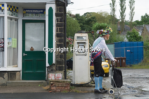 Greenfield, Saddleworth, Yorkshire UK.  Saddleworth Morris man with shopping trolly.