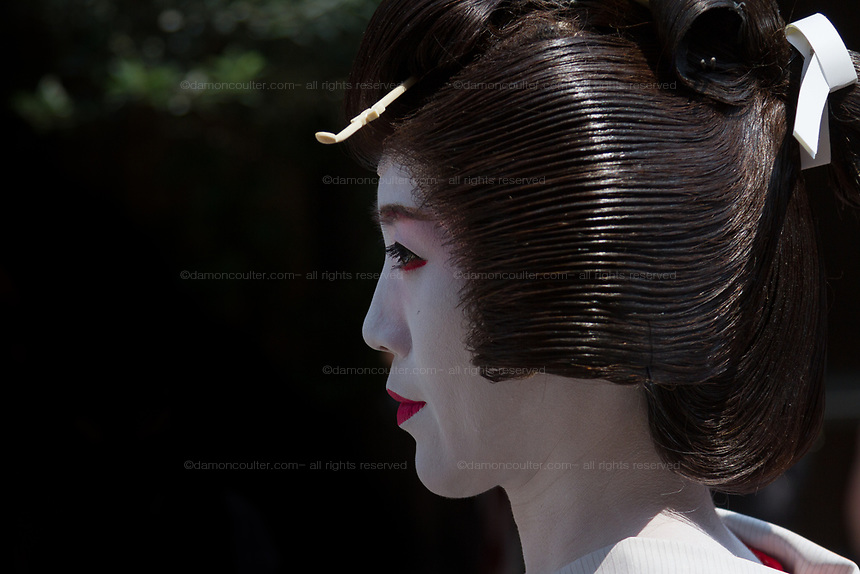A young woman dressed as Geisha take part in the Daigyoretsu or Grand on  first day of the three-day Sanja Matsuri, Asakusa, Tokyo, Japan. Friday May 18th 2018. The Sanja matsuri, or festival, takes place over the third weekend of May in the streets around the famous Senso-ji Temple. It lis one of the biggest festivals in Japan and lasts for three days  (May 18th to May 20th ) with parades of large mikoshi, or portable shrines, carried around the streets by crowds of supporters