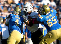 Trevor Guyton of California sacks UCLA quarterback Kevin Prince during the game at Rose Bowl in Pasadena, California on October 29th, 2011.  UCLA defeated California, 31-14.