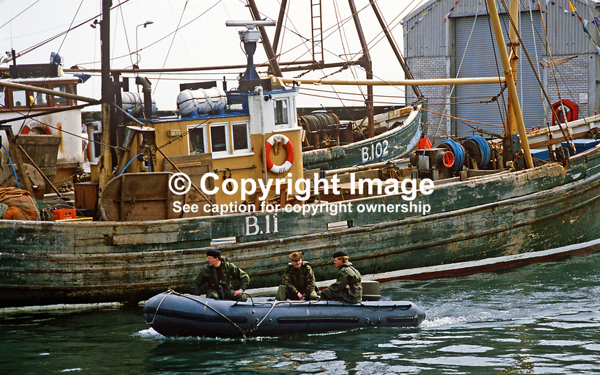 Princess Anne on a May 1985 Royal Visit to the N Ireland fishing village of Portavogie, Co Down, required additional security in the shape of soldiers patrolling the harbour in a RIB, rigid inflatible boat. Princess Anne was there to officially reopen the local harbour. 19850502e.<br /> <br /> Copyright Image from Victor Patterson, 54 Dorchester Park, Belfast, UK, BT9 6RJ<br /> <br /> t1: +44 28 9066 1296<br /> t2: +44 28 9002 2446<br /> m: +44 7802 353836<br /> <br /> e1: victorpatterson@me.com<br /> e2: victorpatterson@gmail.com<br /> <br /> www.victorpatterson.com<br /> <br /> IMPORTANT: Please see my Terms and Conditions of Use at www.victorpatterson.com