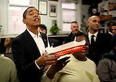 Washington, DC - January 10, 2009 --  United States President-elect Barack Obama receives a chili half smoke with shredded cheese on the side at Ben's Chili Bowl in Washington, D.C., U.S., Saturday, January 10, 2009.   .Credit: Joshua Roberts - Pool via CNP