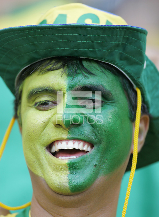 A Brazilian fan cheers on his team before the game. Brazil defeated Australia, 2-0,  in their FIFA World Cup Group F match at the FIFA World Cup Stadium, Munich, Germany, June 18, 2006.